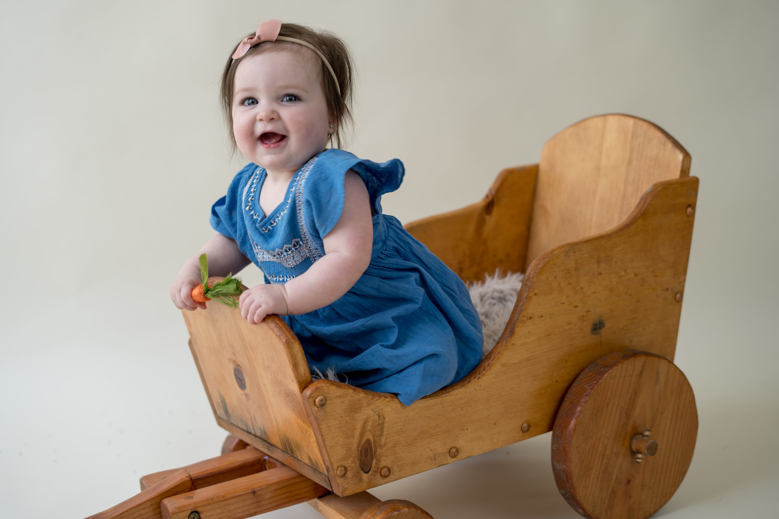 Happy in her wooden wagon.jpg