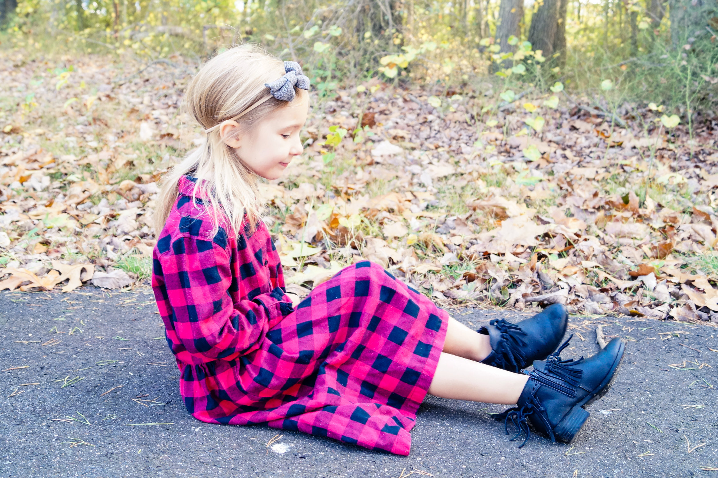 red and black checkered buffalo plaid dress and black leather boots, little girl posing for fall portrait session