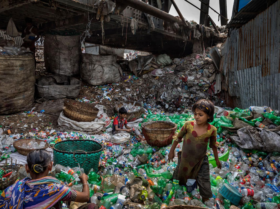 In Bangladesh, a family sorts through plastic to sell to scrap dealers.