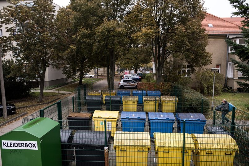 German waste bins; black bins are for general waste, yellow is for plastic, brown is for compost, blue is for paper