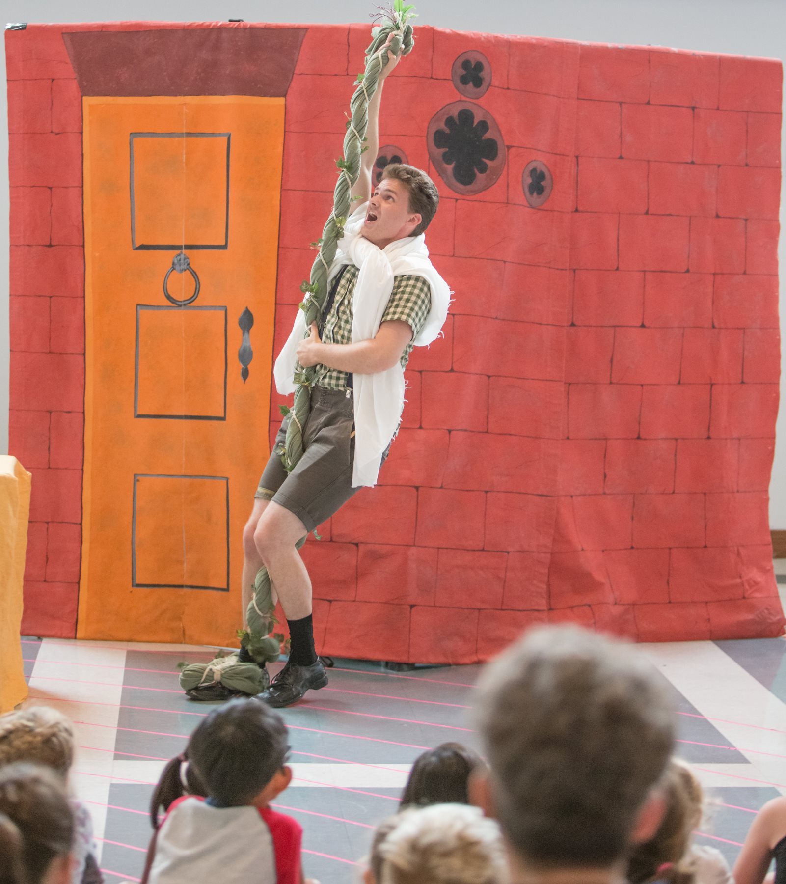 Nolan is ascending into the heavens on a giant beanstalk in front of an audience of young library-goers in the children's opera  Jack and the Beanstalk  with Manitoba UNDERGROUND Opera, 2018.