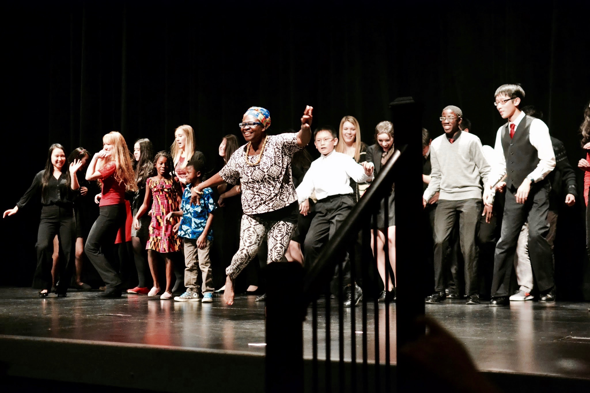 Student volunteers dancing on stage at the annual 'Ghanaian Culture Night' in Mukilteo, WA.