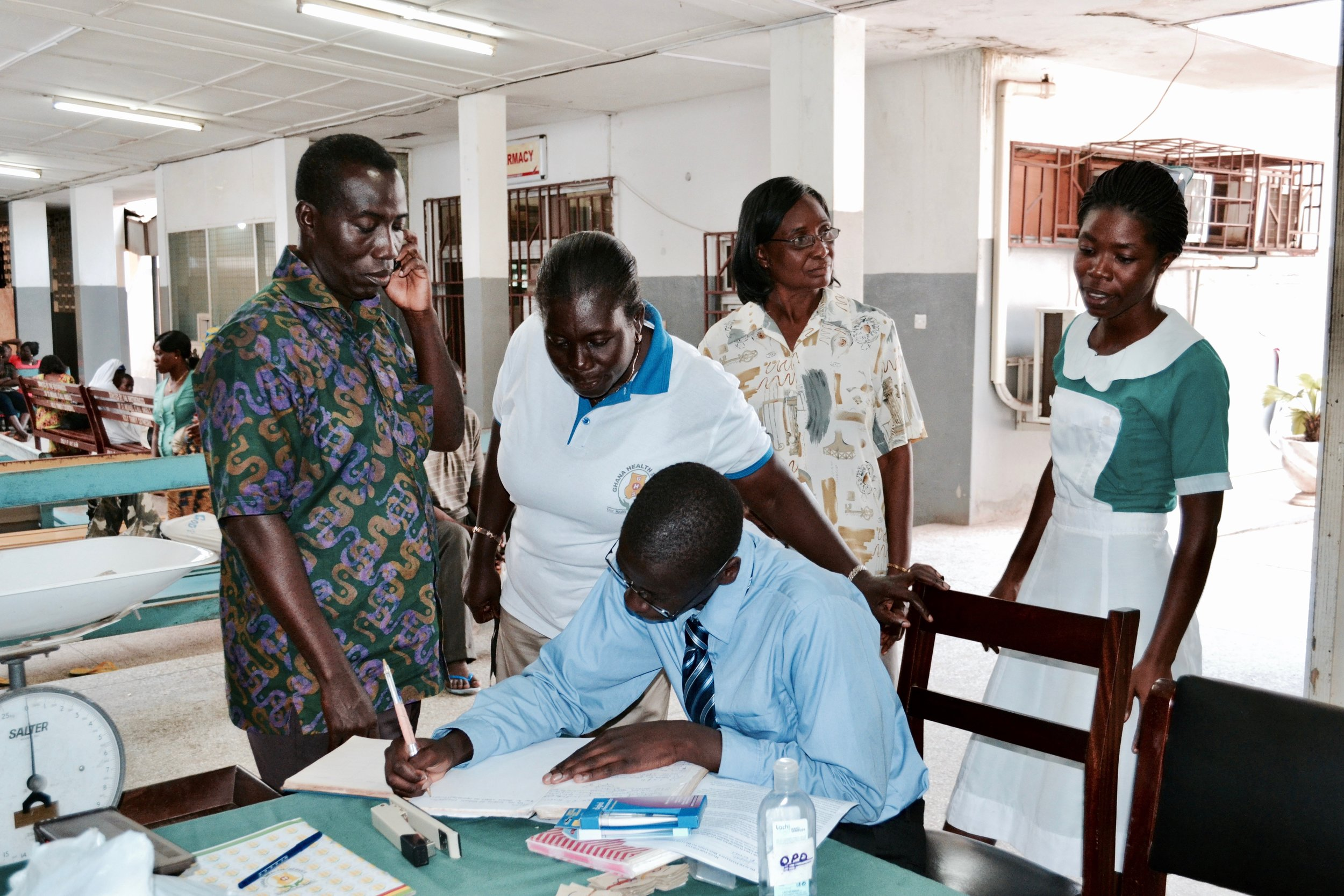 Joel Bervell signing the registry after donating medical supplies to Labadi Hospital