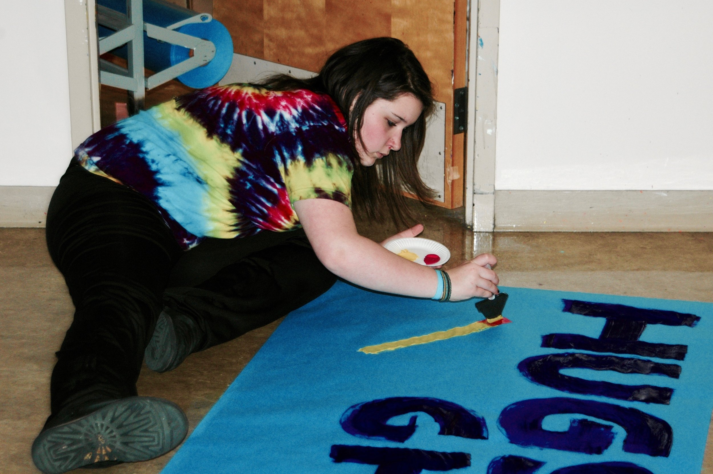 Students at Kamiak High School creating posters for an upcoming school supply drive