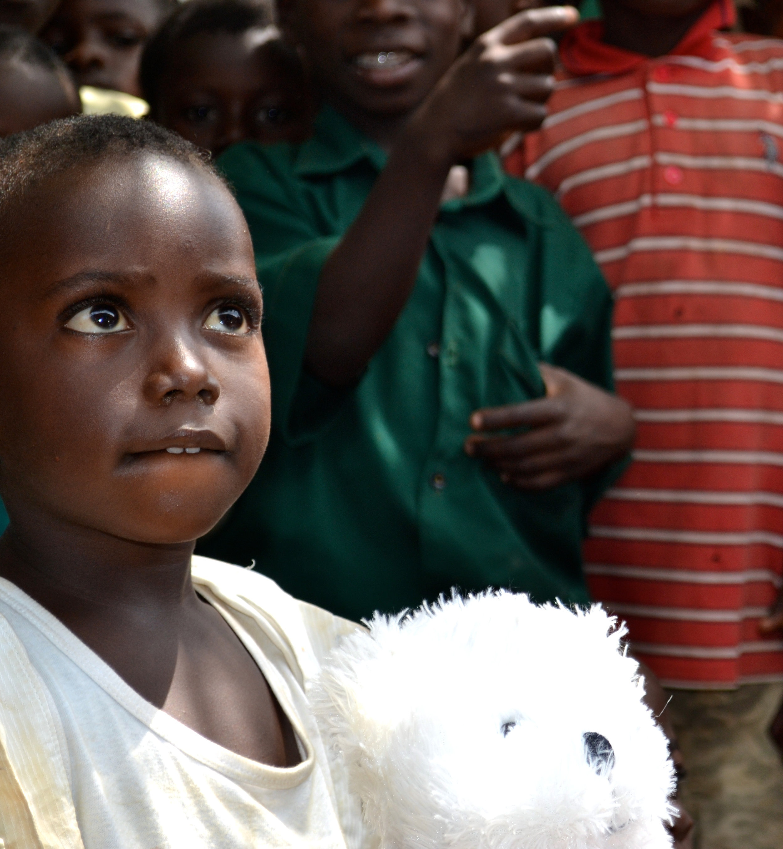 A student from Hobor orphanage with a new teddy bear