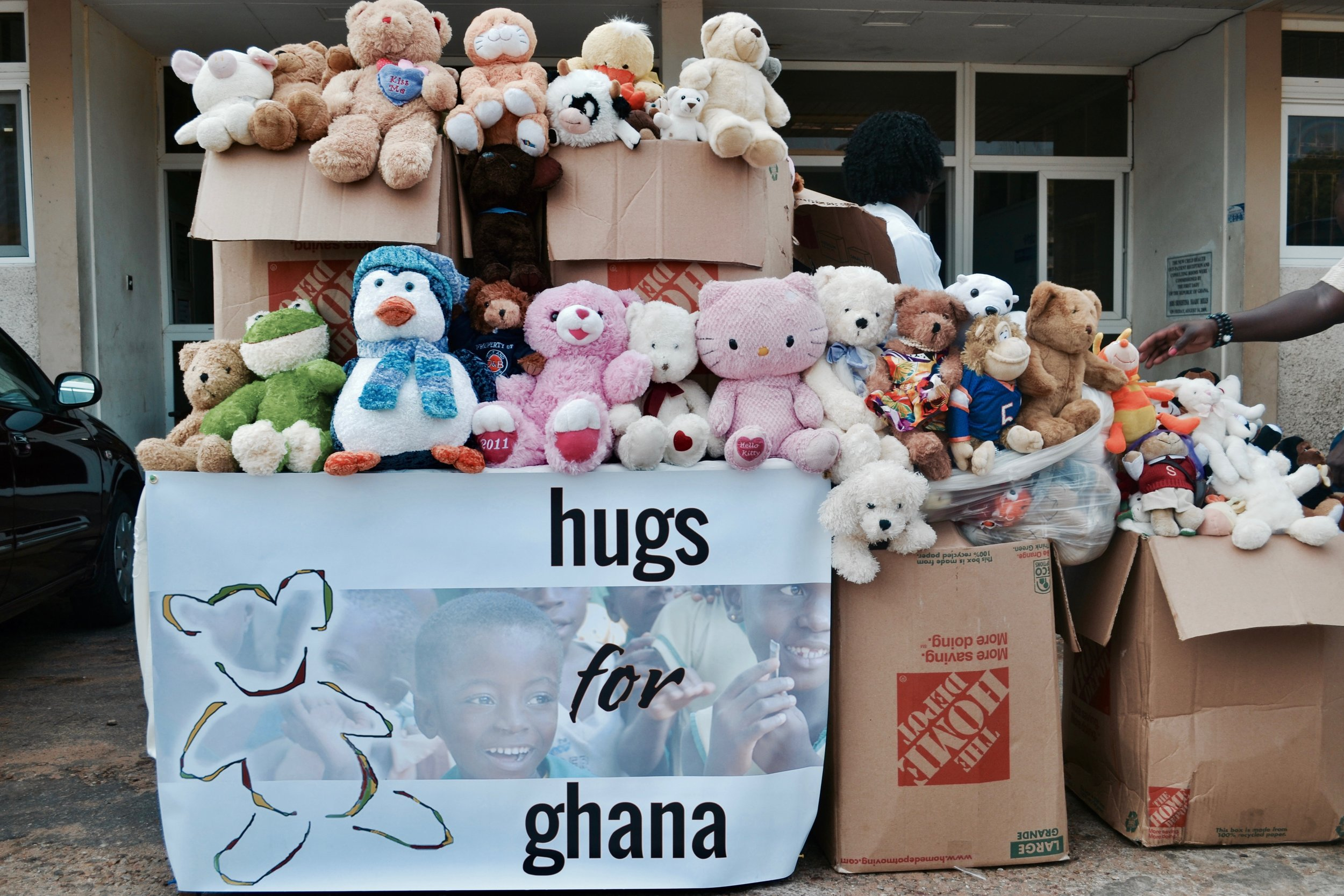 Hugs for Ghana bringing stuffed animals to Korle-Bu Hospital in 2013