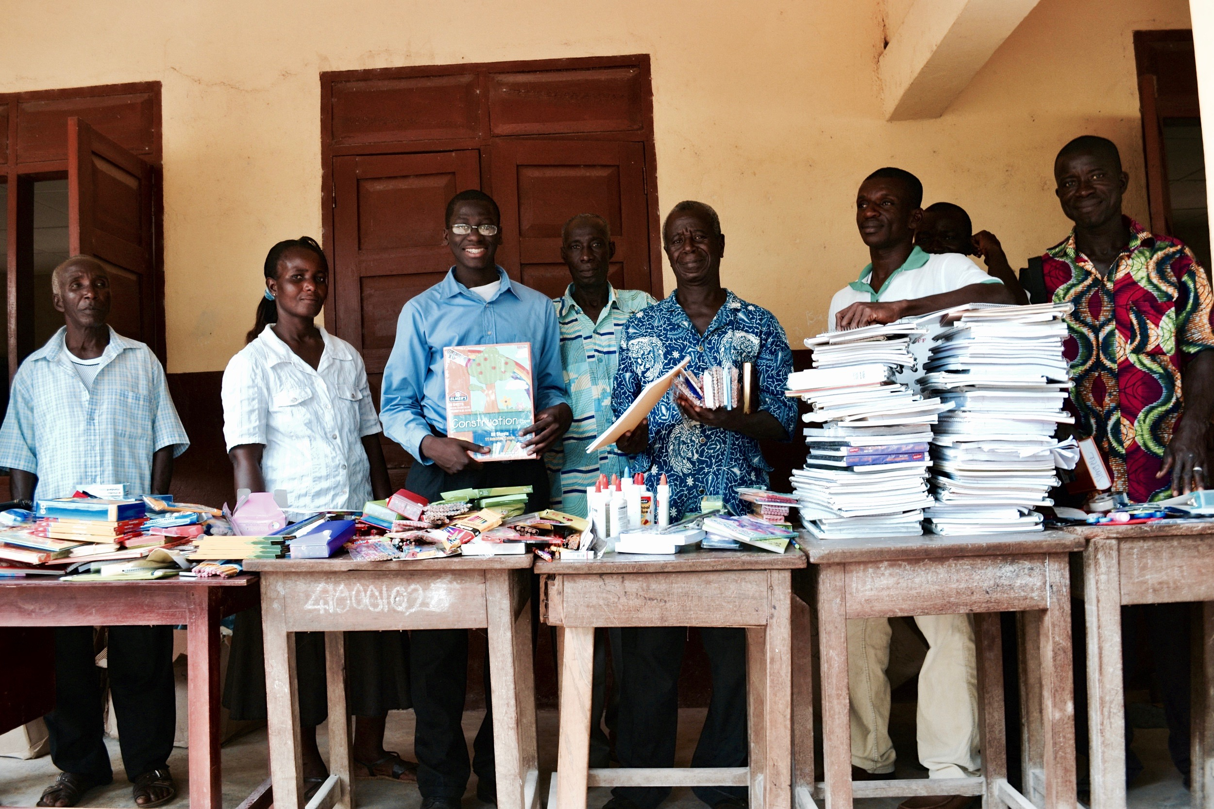 Joel Bervell sharing school supplies donated to Tikobo II Elementary School through 'Project Educate' during a trip to Ghana in 2011