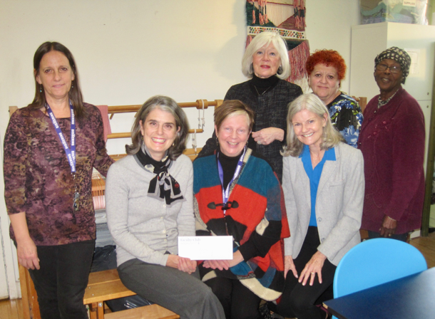 Marianne, Jo-Lynne & Susan present a cheque to Sistering staff.
