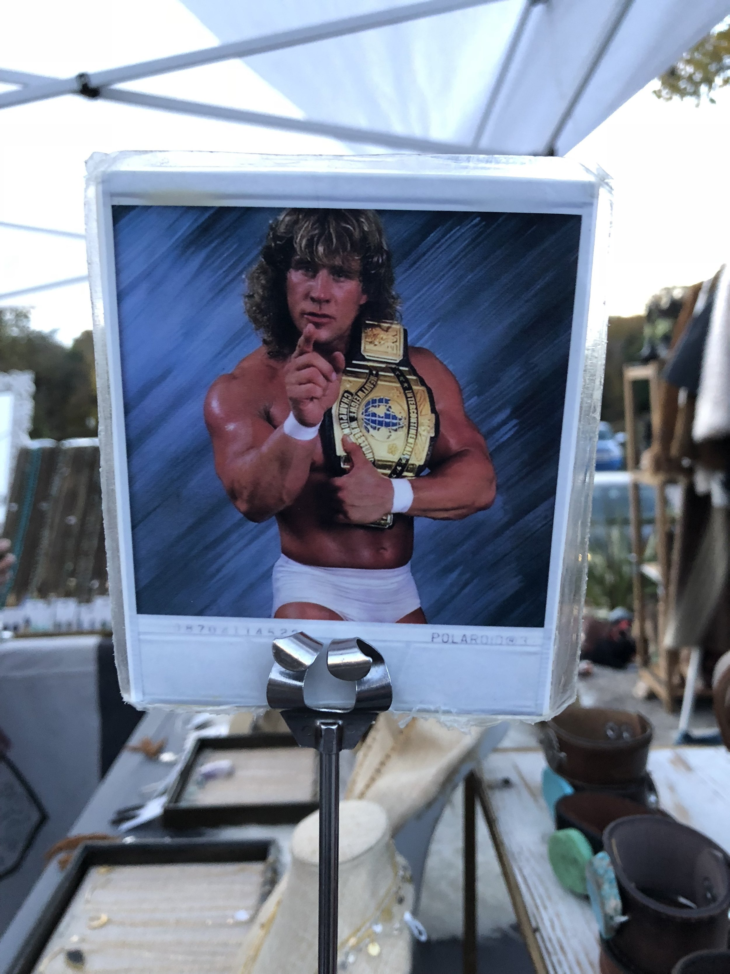Instead of giving you a number for your order, they give you a picture to place on your table so that they can find you and bring your food. Pictures ranged from old wrestlers and celebrities to cartoon characters.