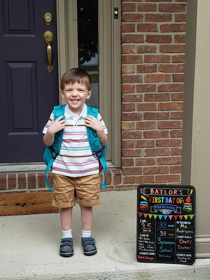 So excited to start school that he could hardly stand still for pictures.