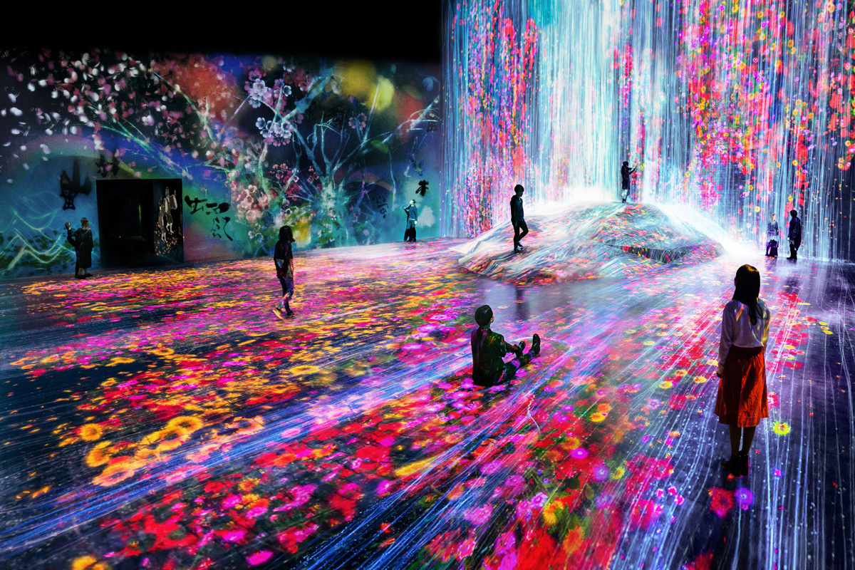 Universe of Water Particles on a Rock where People Gather. Courtesey teamLab