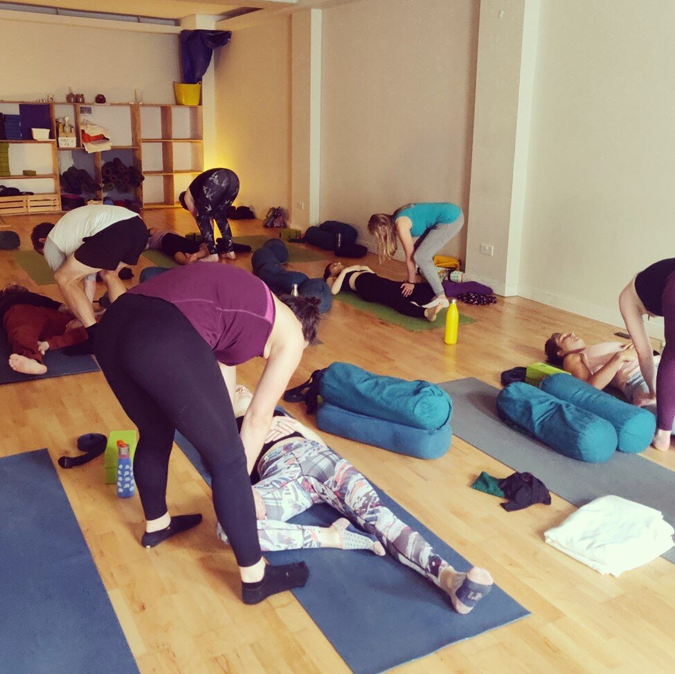 Practicing Thai yoga massage techniques