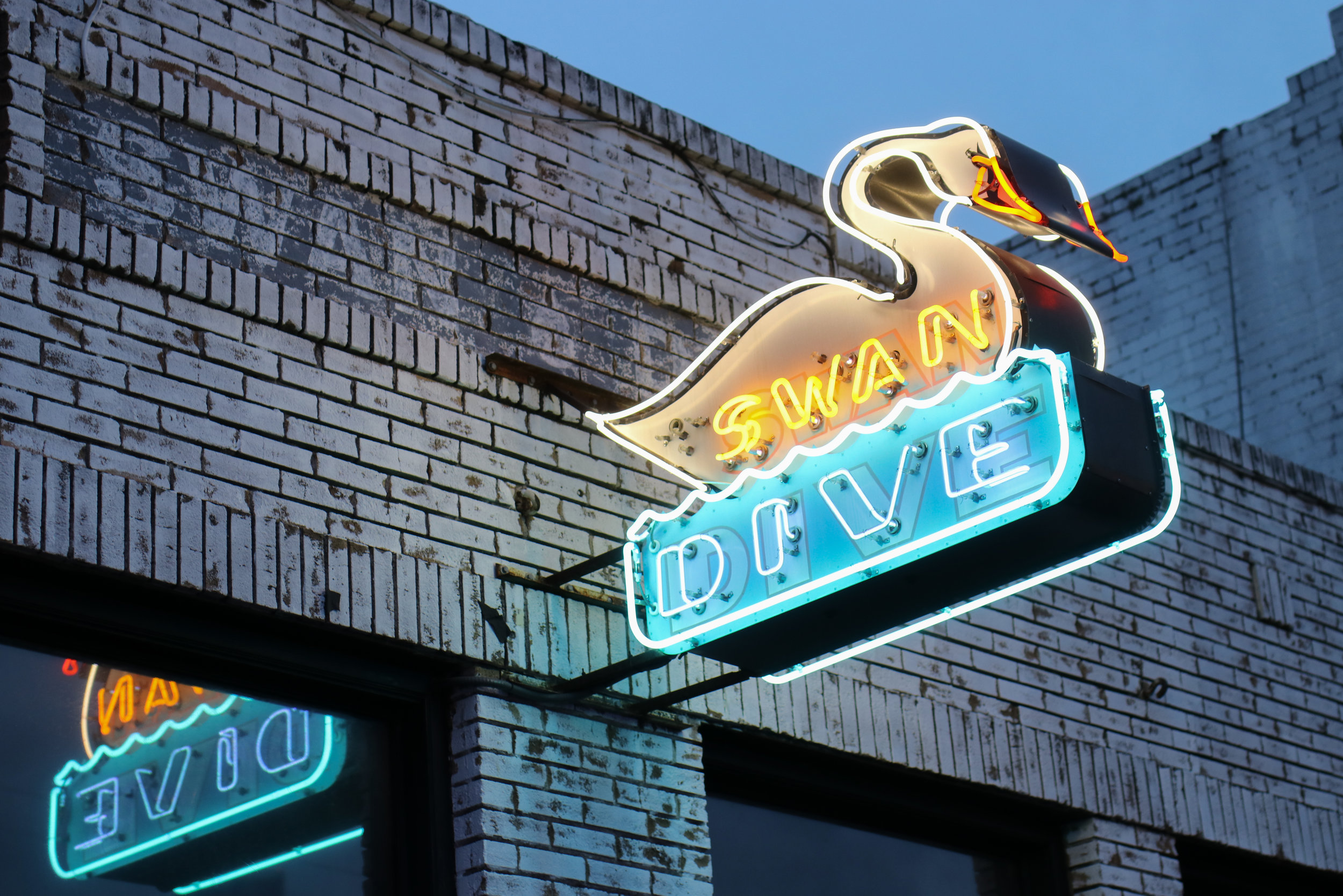 Swan Dive (615 Red River Street), a lounge that hosts live music, dance parties, burlesque, and more.