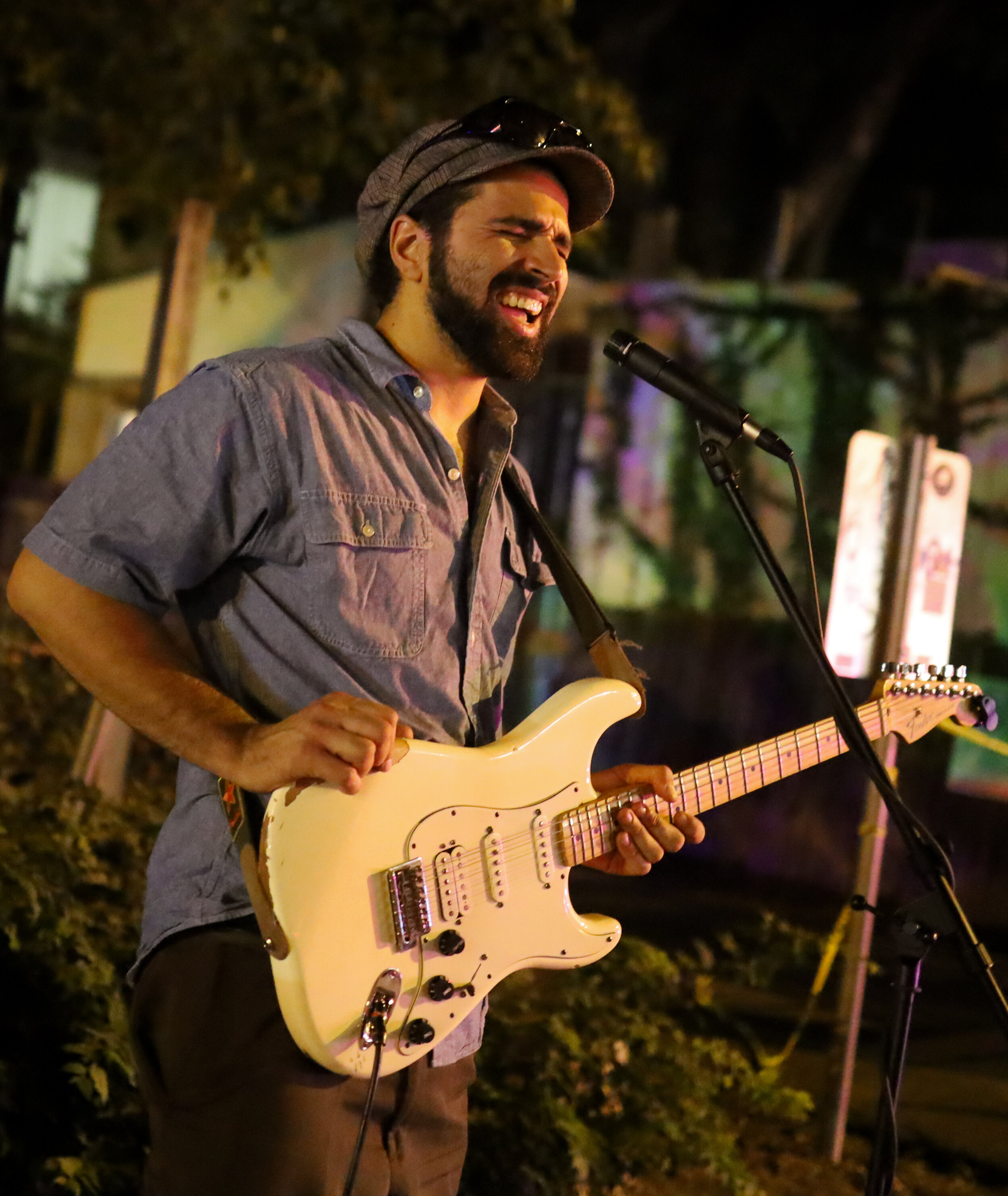 Michael Simon plays and sings for the crowd along Barton Springs Road