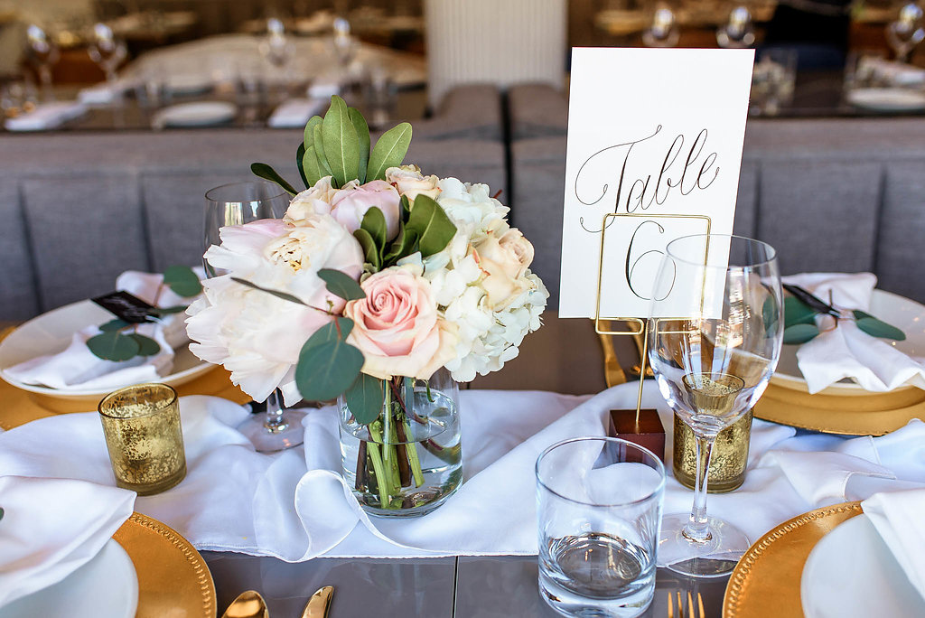 table number calligraphy bouquet table setting design