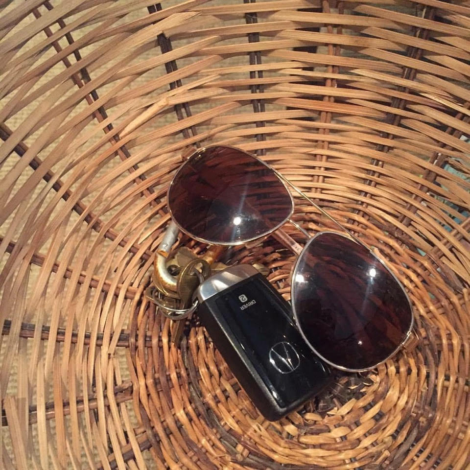 Designate a trendy basket for items like keys, sunglasses, or wallets.