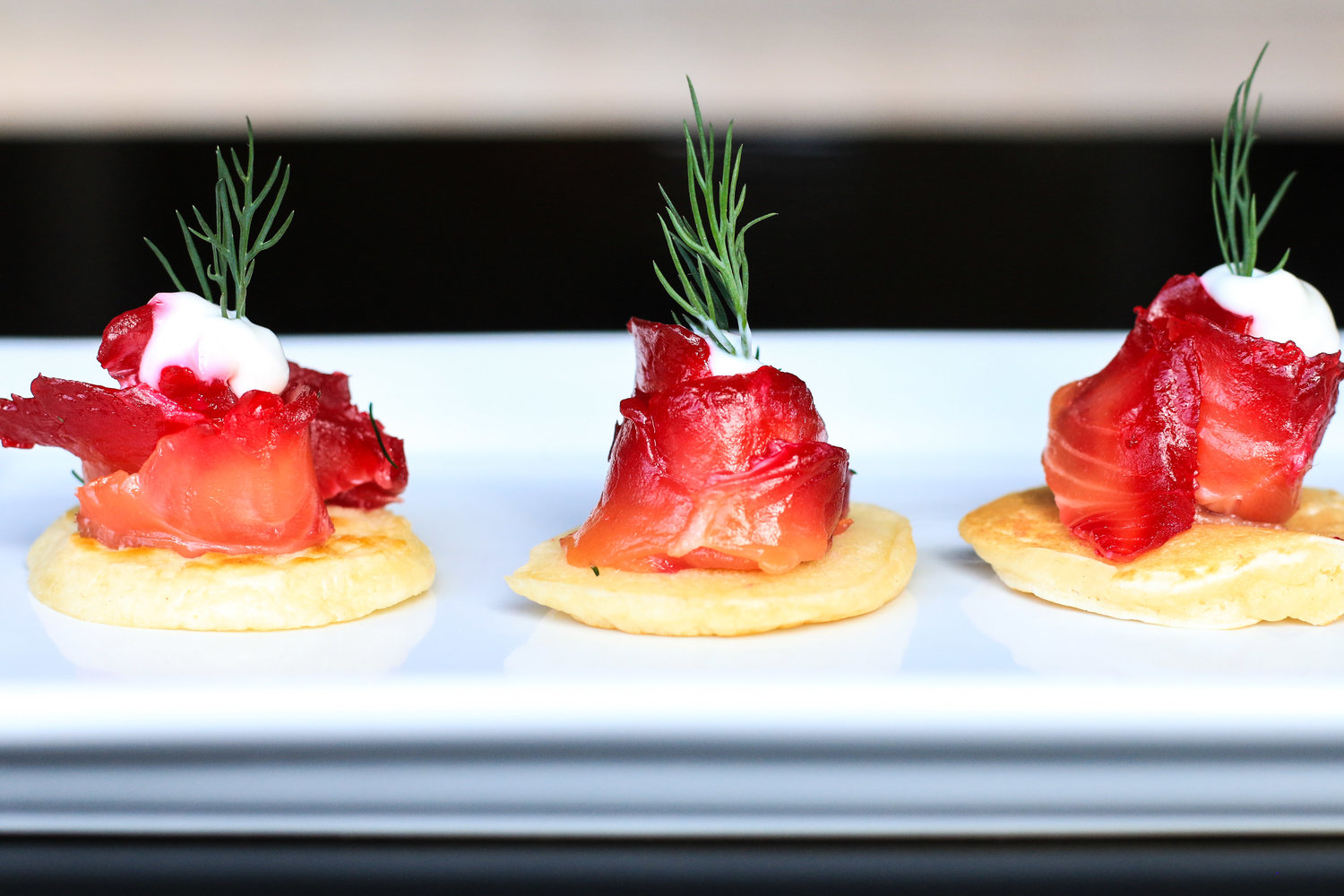 Beet and Vodka Cured Salmon Served on Blinis with Creme Fraiche & Dill