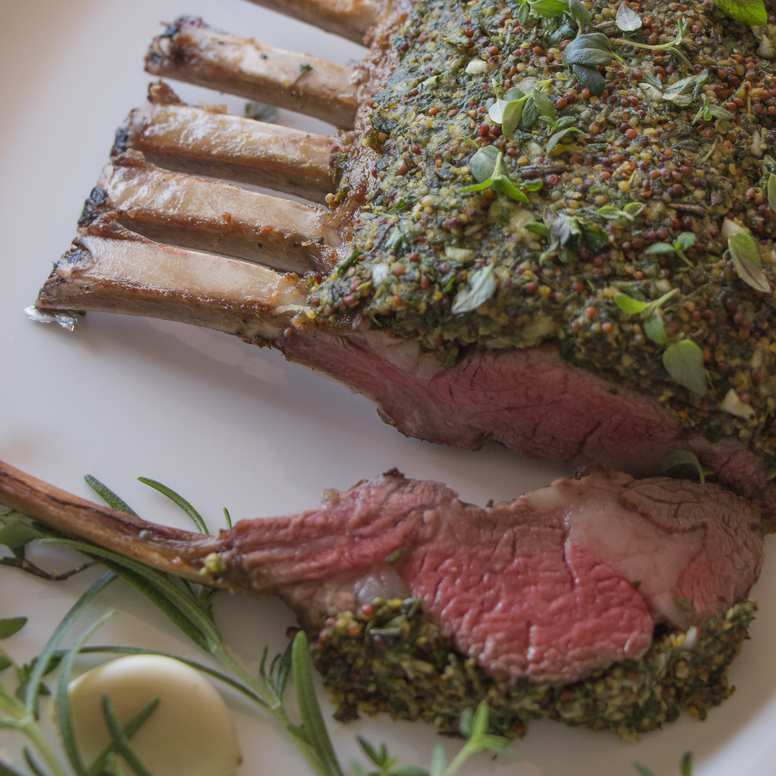 Herbed Rack of Lamb with Rosemary and Pomegranate Sauce