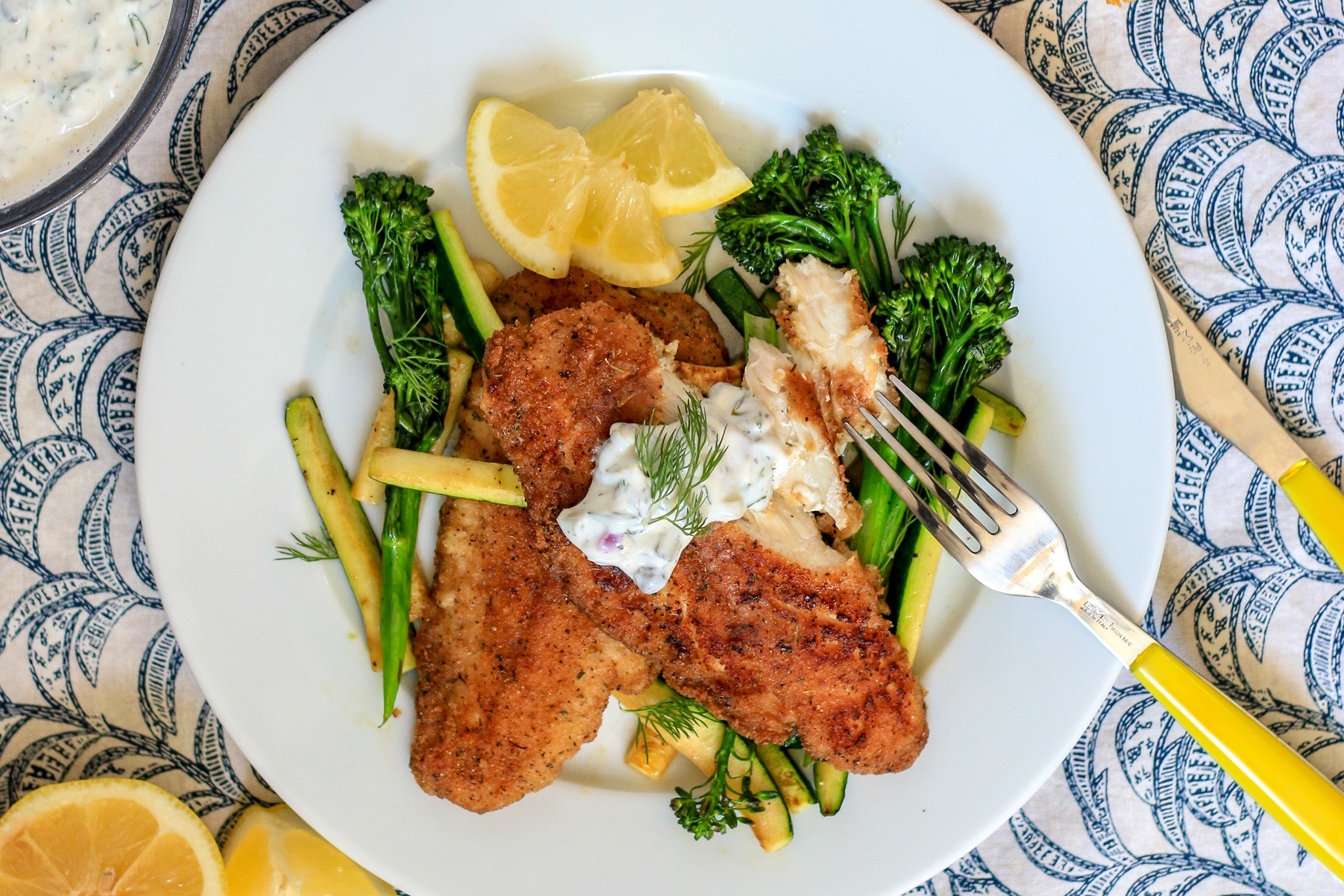 Lightened Up Tartar Sauce with Breaded Fish Fillets and Sautéed Zucchini and Broccolini