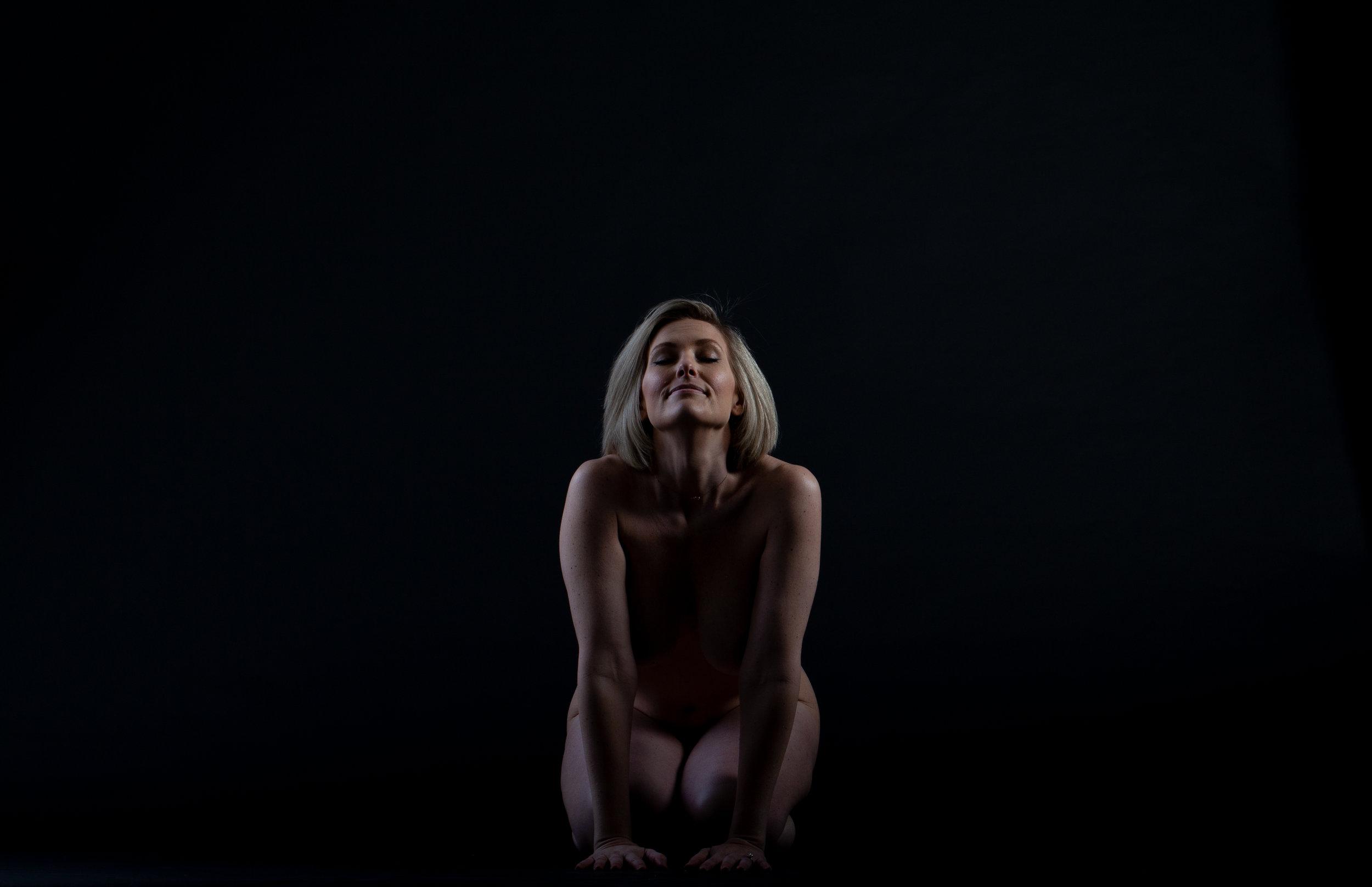 Heidi kneeling eye closed .jpg