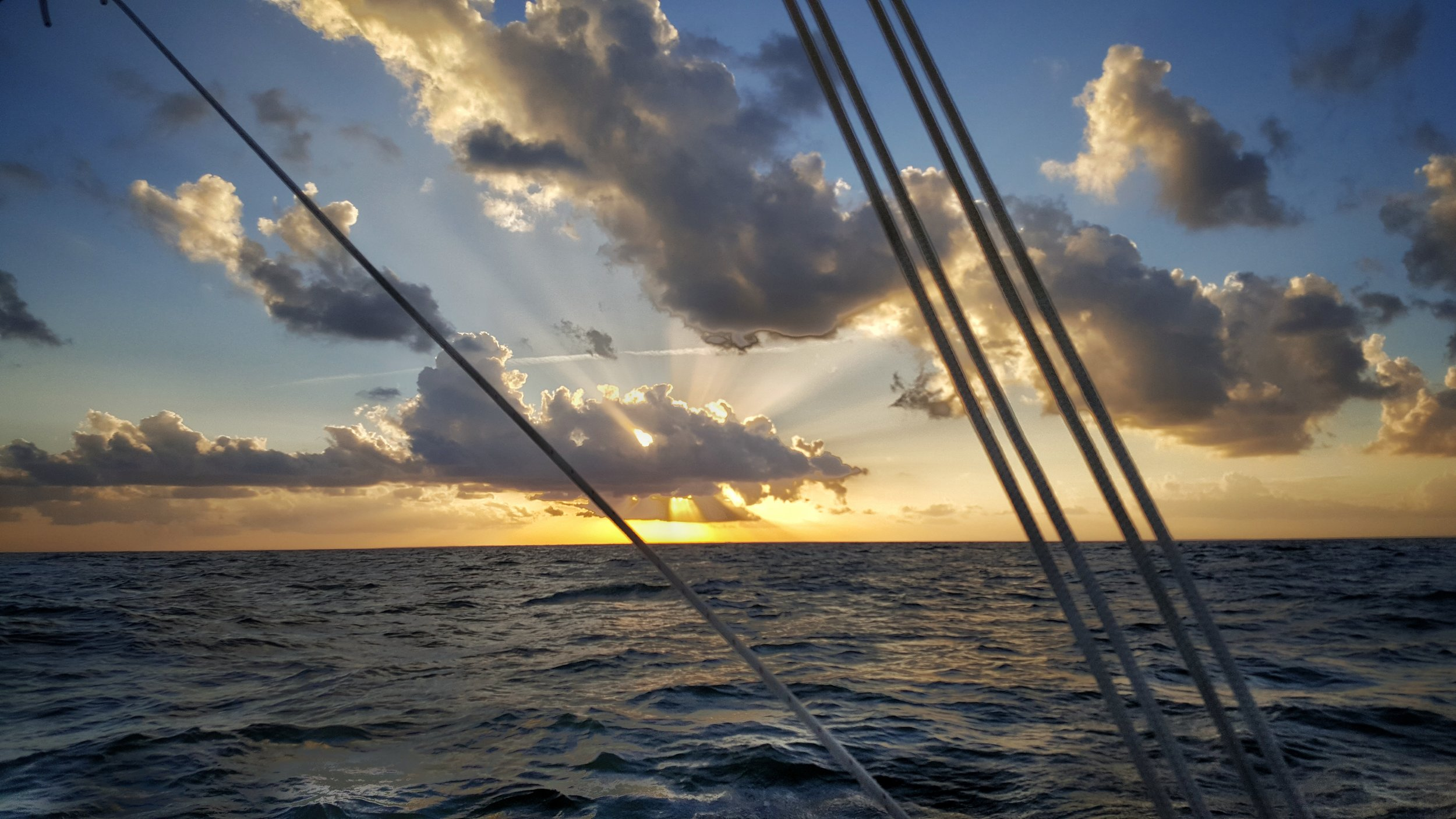 Sunset at sea, just after 'throwing' my back out at the mast