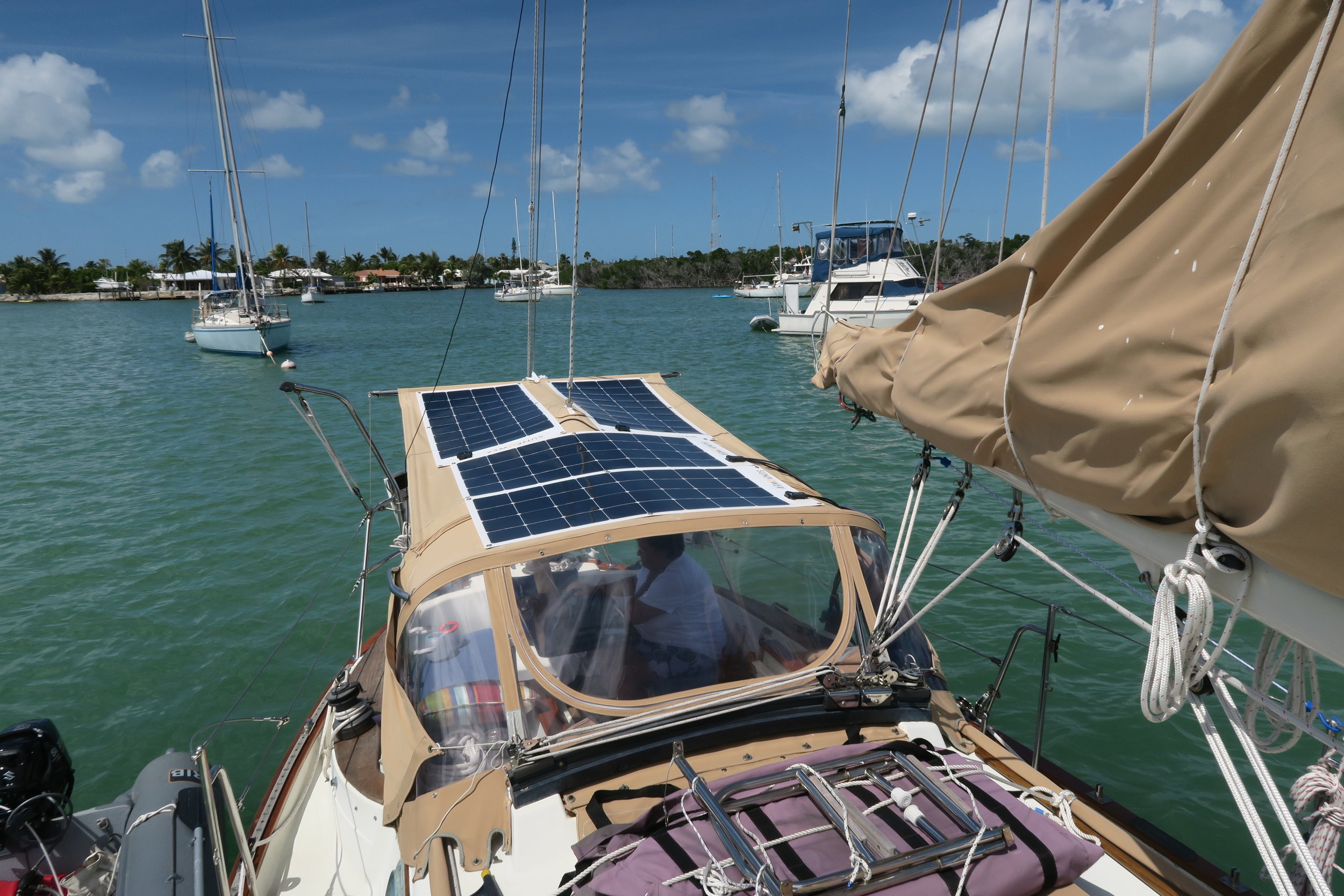 Our four SunPower 100 watt solar panels, mounted on our dodger and cockpit awning with Loxx Grommet Snaps