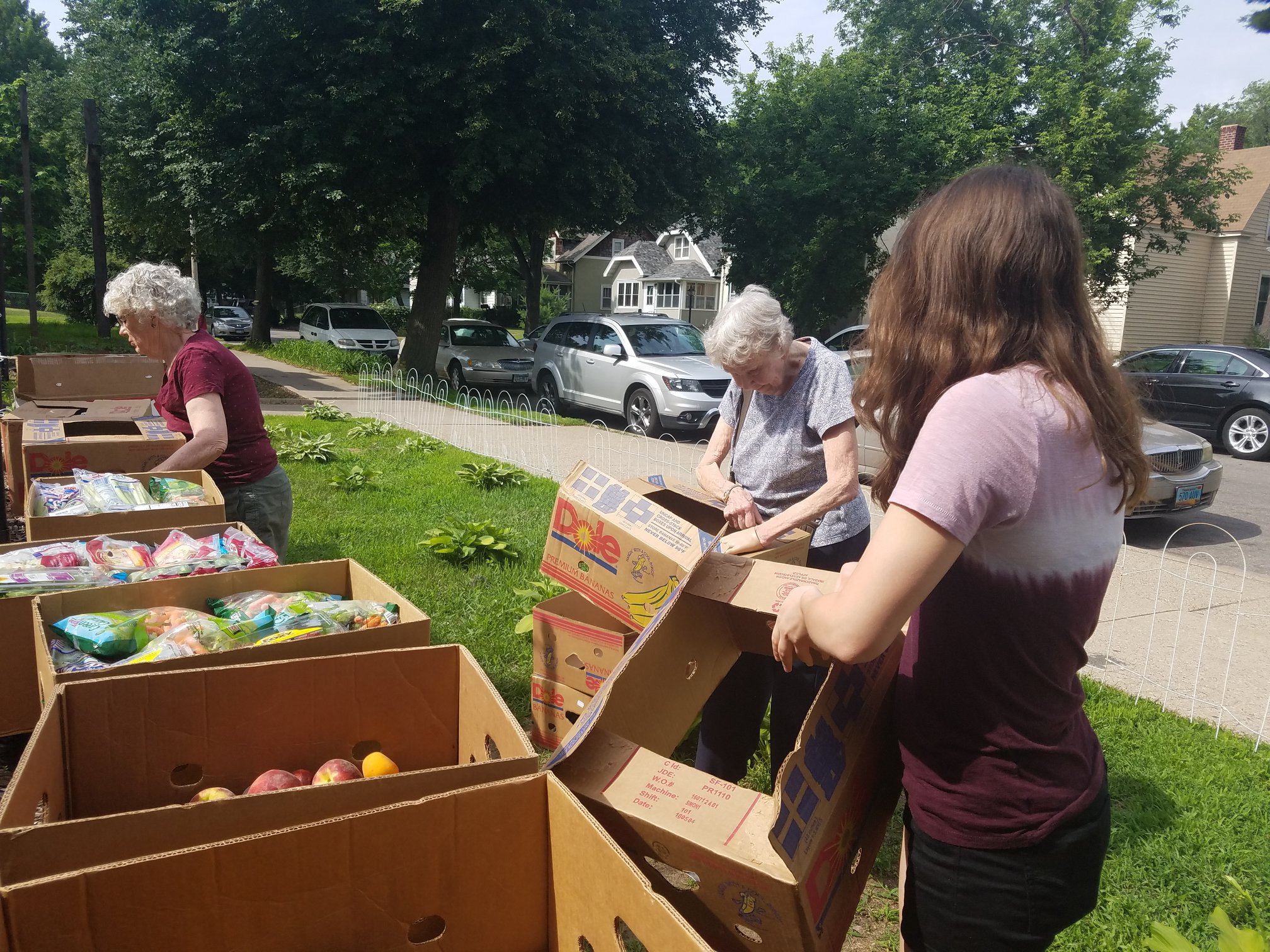 Food is sorted for distribution on site, using every available surface - even the retaining walls outside.
