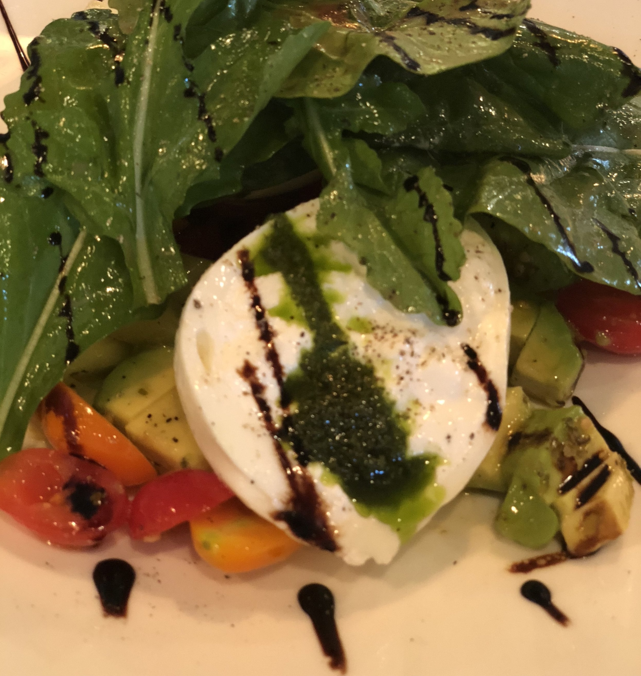The aged balsamic compliments the creaminess of the fresh burrata.