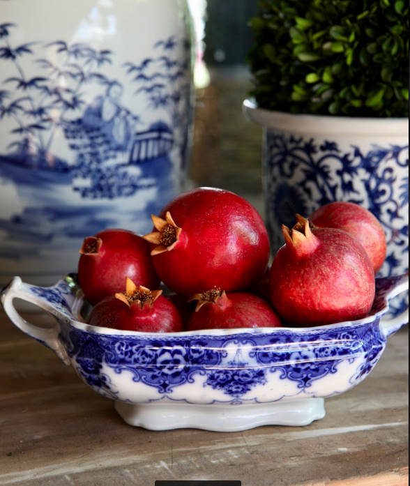 Pomegranates piled high in a lovely dish make a statement.