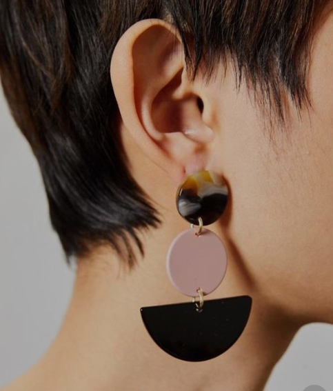 Spice up a monochromatic outfit with these fun earrings by  Rachel Comey