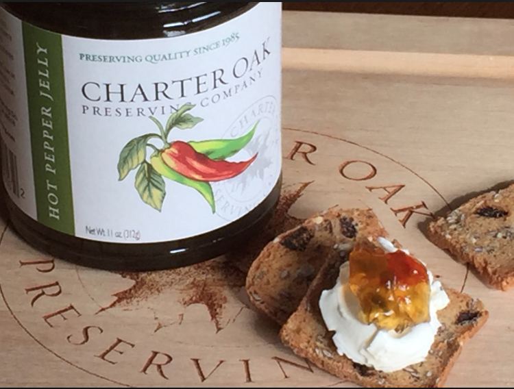 Charter Oak Preserves help out with a quick appie. Hot Pepper Jelly tops a cracker with a dab of cream cheese.