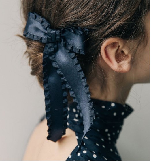 Twist hair to the side, add a bow and you are making a statement.