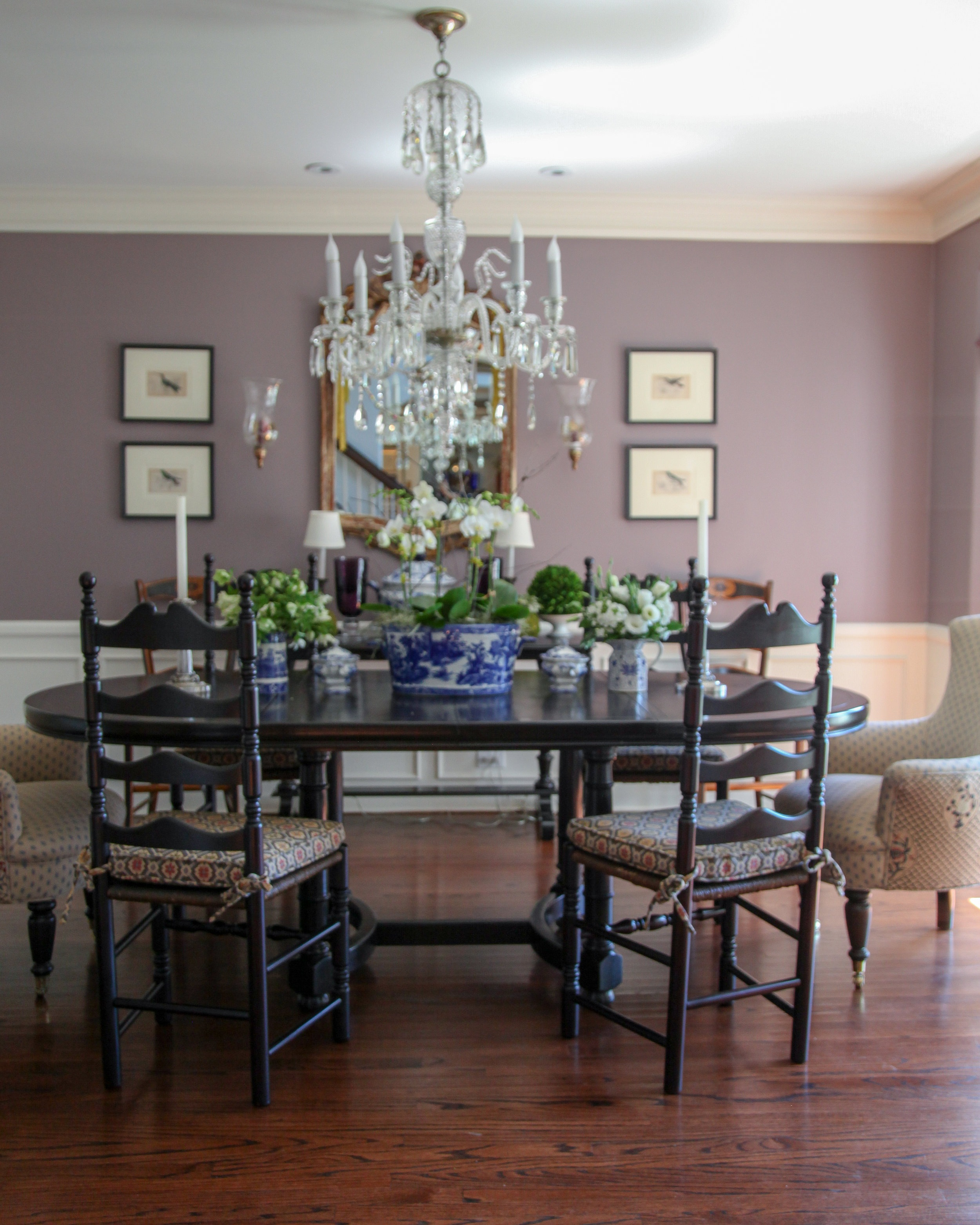 These walls are painted  Benjamin Moore's Wet Concrete . Blues and natural wood tones marry well with this dark mauve color.