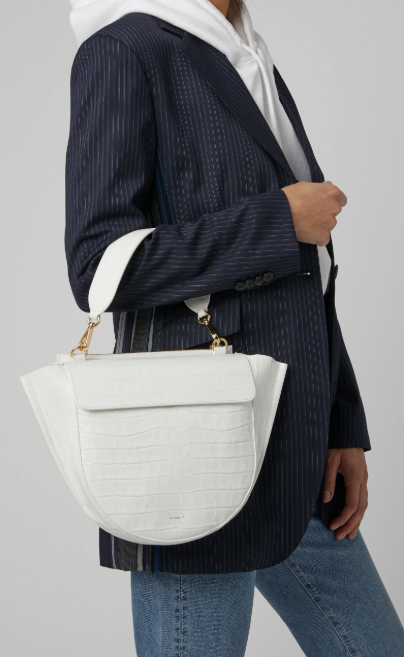 Crocodile embossed  Hortensia handbag by Wandler i n optic white looks chic with the top handle but also has a long strap for crossbody convenience.