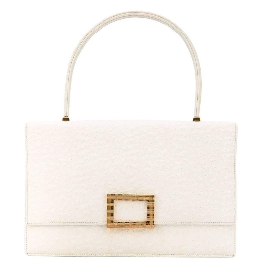 White Beluga whale leather is the perfect touch to add structure and interest to this 1960's Hermes bag offered on  1st Dibs.