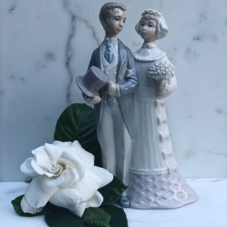 Keeping it in the family - a third generation will use this Llardro wedding cake topper.