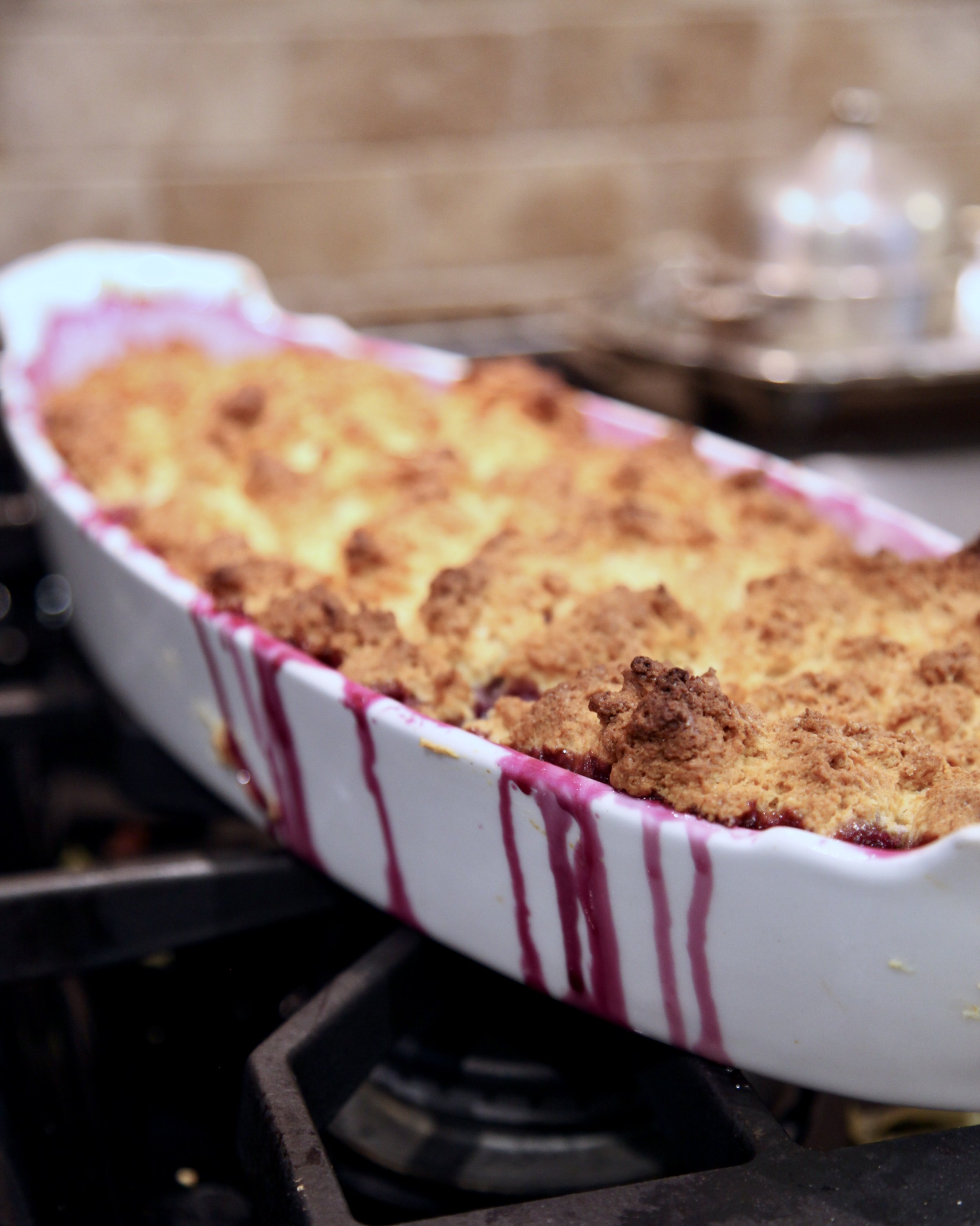 The cobbler is baked in a 19th century French baking dish.  Warning: oozing might occur.