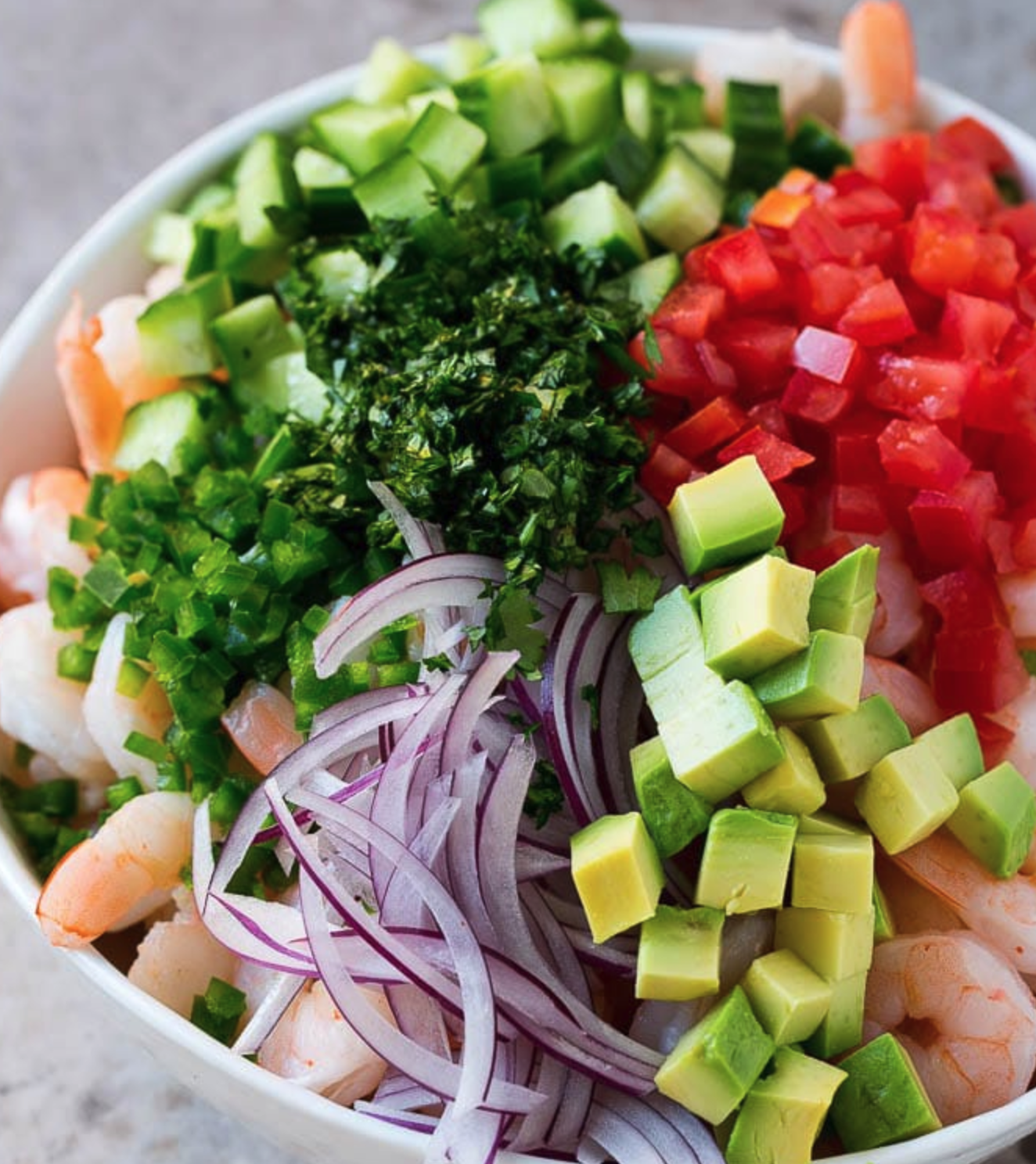 Shrimp Ceviche is loaded with fresh ingredients and then marinated in lime, lemon and orange juice.