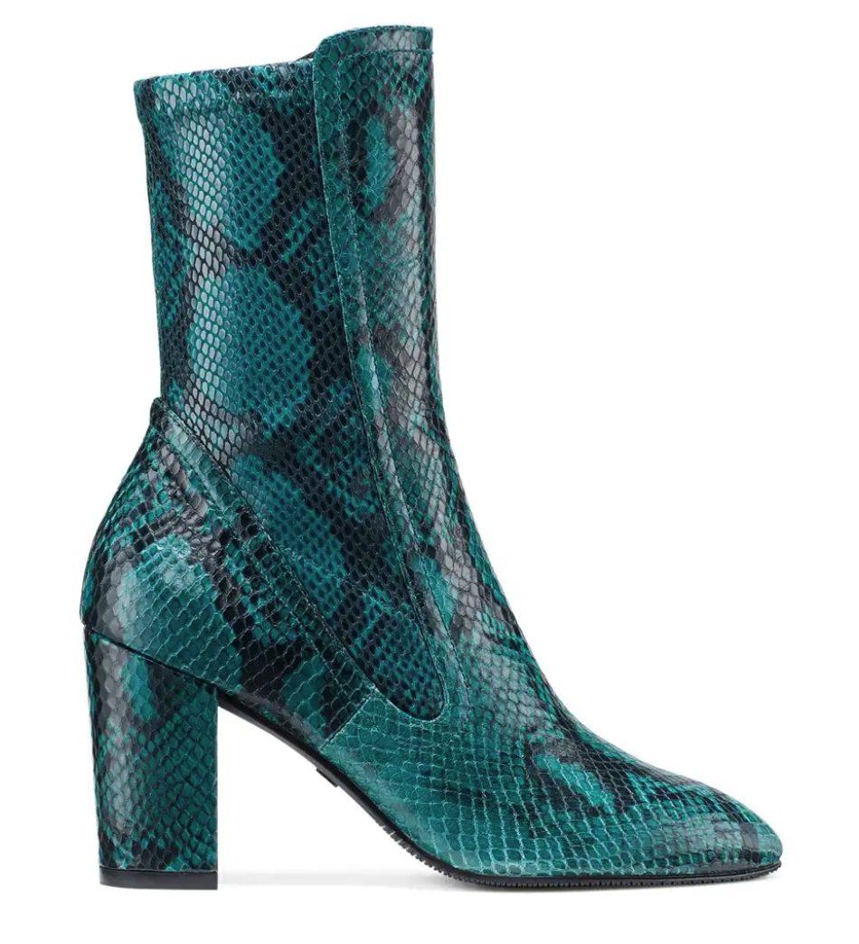 Emerald green and mid-calf - ooh the possibilities… - Crazy but true… Stuart Weitzman changes it up.