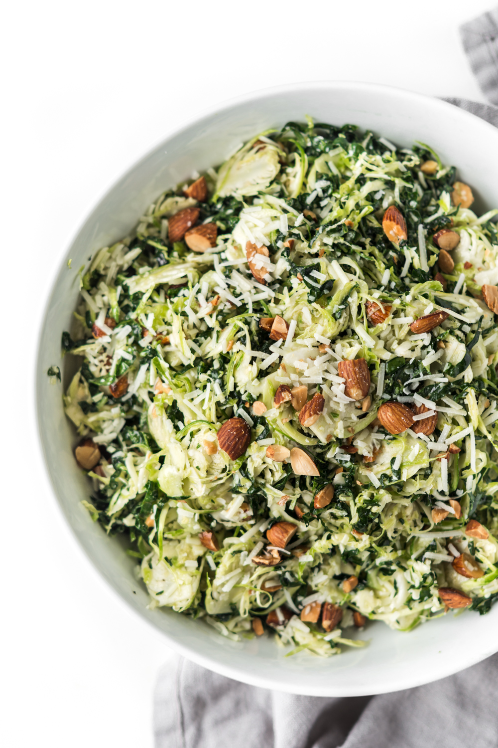 kale and brussels sprout salad with pecorino and almonds