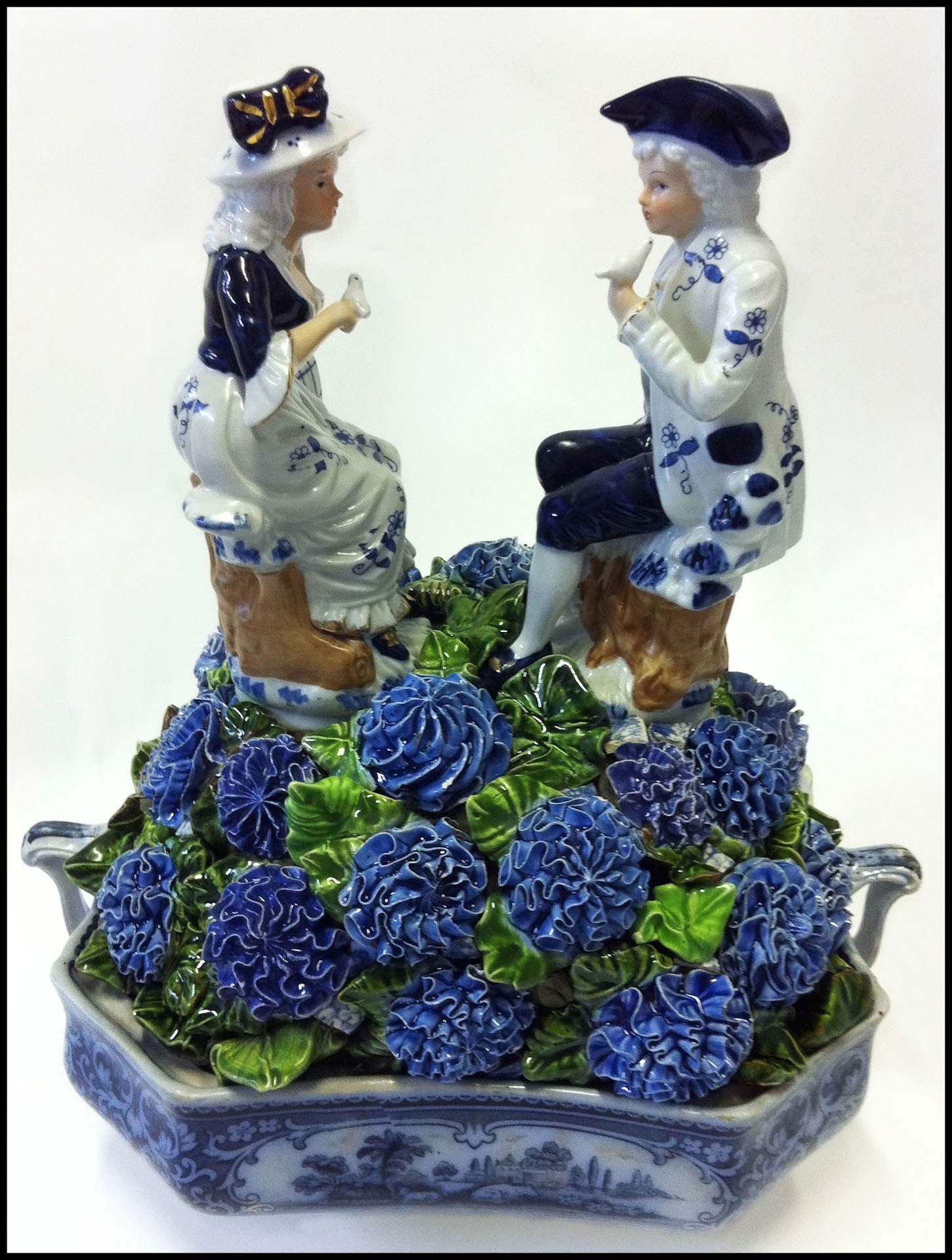 """BLUEBERRY HILL 13"""" x 12"""" x 8""""   3D sculpture example  using blue and white china and figurines. ( view more pieces like this under topiary section)"""