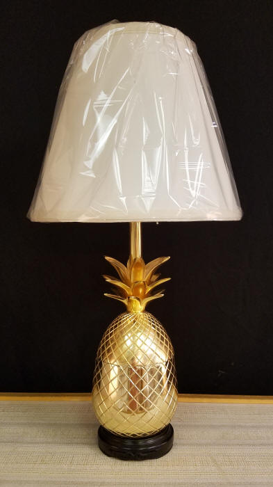 """Pineapple Lamp    This Brass Plated Pineapple Jar makes a very Welcoming Lamp. Works well in many locations, including your front entrance as you invite friends into your home. It stands 21-1/2"""" tall, including the lampshade.    $150.00, plus shipping"""