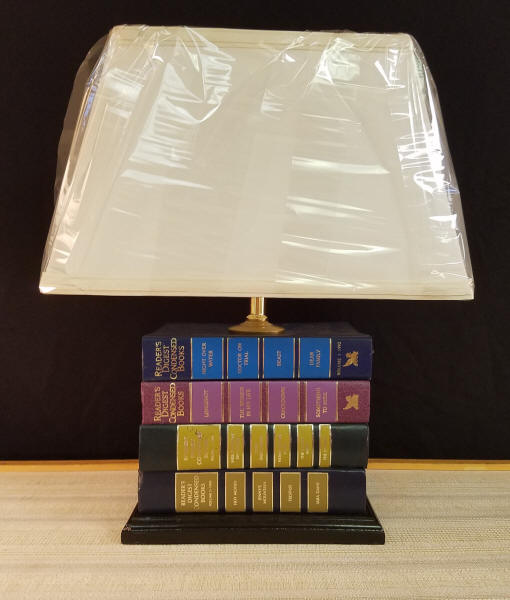 """Reader's Digest Book Lamp    This lamp was made from vintage reader's Digest Books. It stands 16-1/2"""" tall and includes a Rectangle Shaped Lampshade.    Great lamp for any room, but a must for an avid reader or for that perfect reading area.    Keep in mind, we can make lamps from your objects, and this includes your books. We commonly make lamps from old medical or law books that were used by the owner. We recently made a lamp from Harry Potter books that a client provided.    $150.00, plus shipping"""