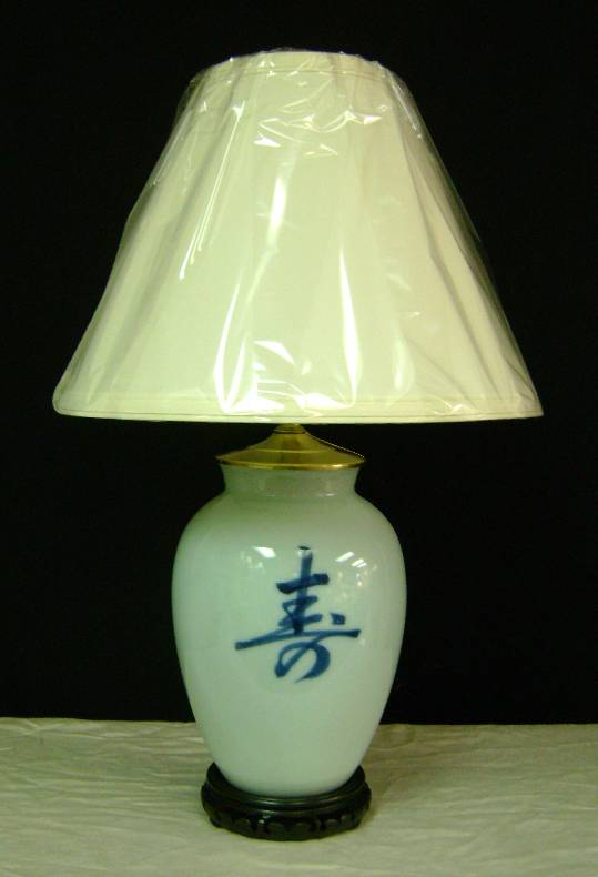 """Chinese Symbol Vase Lamp    Simple design... Blue Oriental Symbol painted on a light-blue porcelain vase.    Stands 21"""" high. Shown with a #509 Parchment Linen lampshade.    $150.00 complete, plus shipping"""