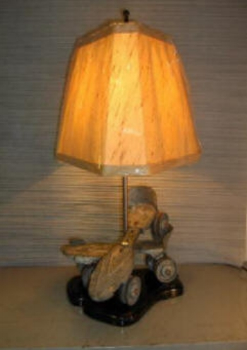 """Vintage Roller Skates Lamp    This vintage pair of metal roller skates make another very interesting lamp.  Did you have skates like these? You can have a lamp to reminisce. 19"""" high.    $155.00, plus shipping"""