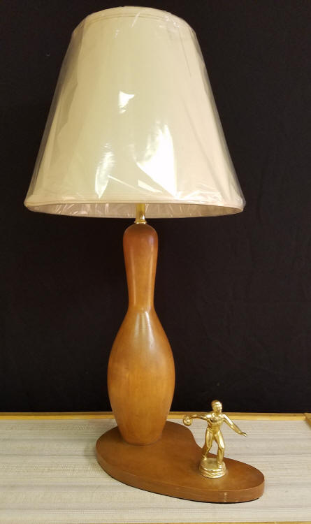 """Vintage Bowling Trophy Lamp    We restored this Vintage Bowling Lamp. It appears to have been presented originally as a trophy. We did not restore the wood, and it captures the Patina that makes it special.    A must lamp for the Bowling Enthusiast in your life (or is that you?)     It stands 27"""" tall, including the Custom lampshade.    $165.00, plus shipping"""