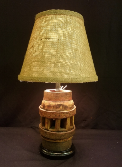 """Small Wagon Wheel Hub Lamp    This lamp is made from a small wheel hub, probably from a pull cart or other type small vehicle. We more commonly see the standard, larger size hubs. This lamp stands only 15.5"""" to the top of the custom Burlap lampshade.    $150.00, plus shipping"""