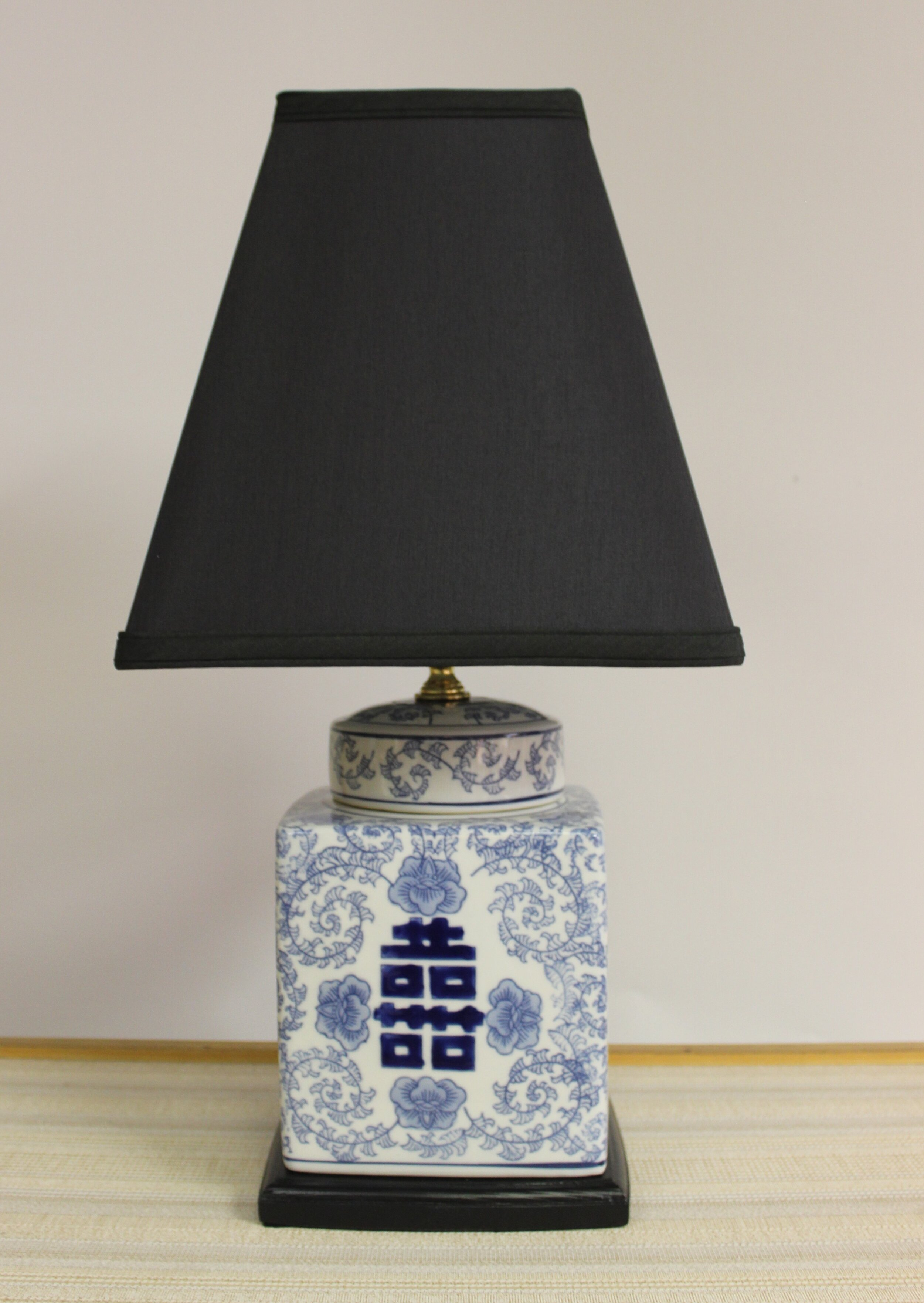 """Square Blue & White Cannister Lamp This classic style lamp stands 20"""" tall. The shade measures 10"""" square at the bottom measurement. The jar has it's own lid, at the top and we make the black wood base to match the profile of the cannister.    $195.00, plus shipping"""