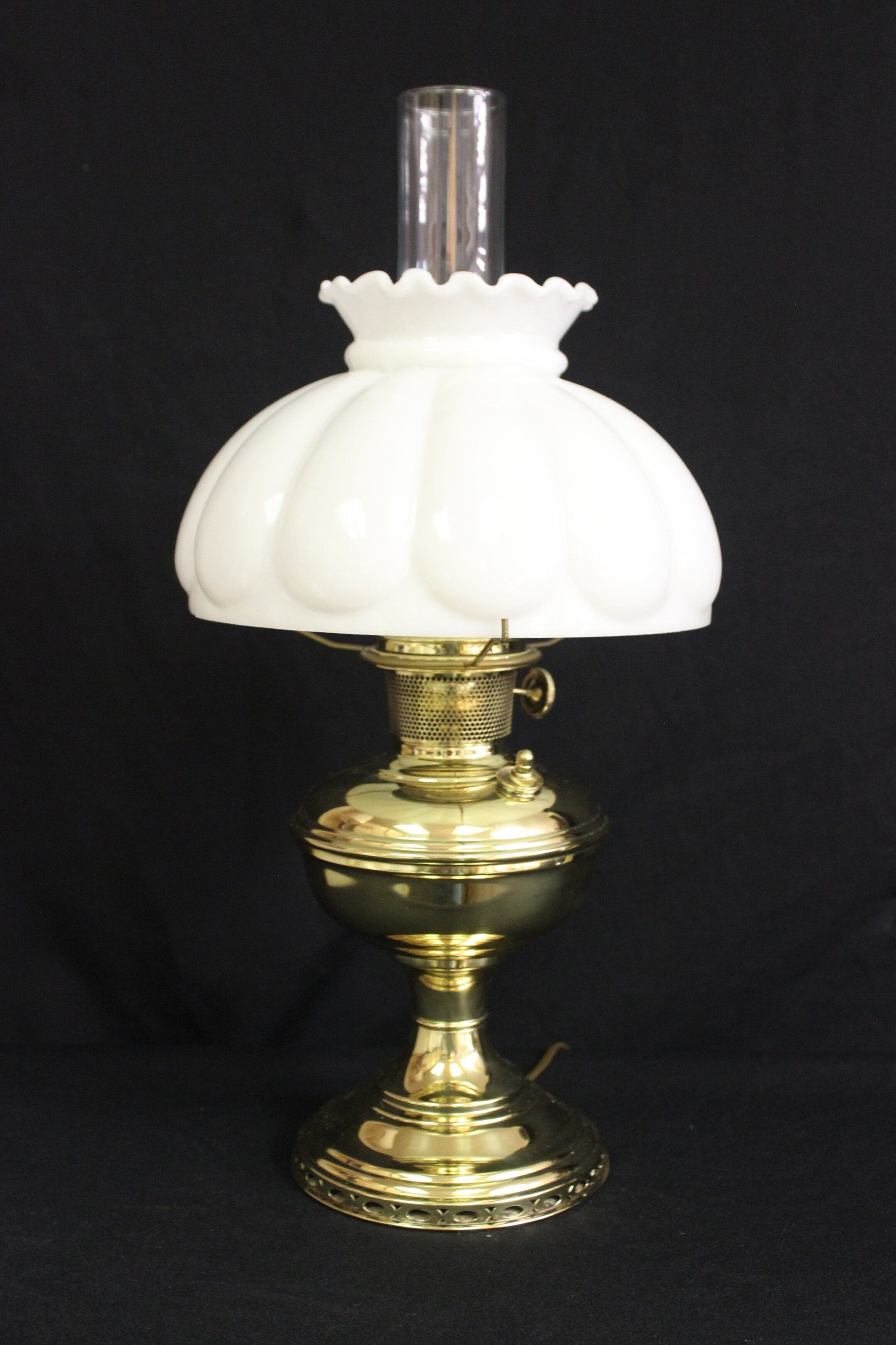 """Original Aladdin Model #9 Brass Lamp.  This lamp was originally a kerosene lamp, and was made by Aladdin from 1920-1922.    The restoration work includes: Electrifying, Polish & Lacquer, New glass chimney and new 10 Opal Glass shade (Shade made in the US).    The lamp is wired with high quality electrical components. Gold colored lamp wire extending approximately 7 feet from the wood base to the plug.    This lamp stands 21"""" high.  $295.00, plus shipping"""