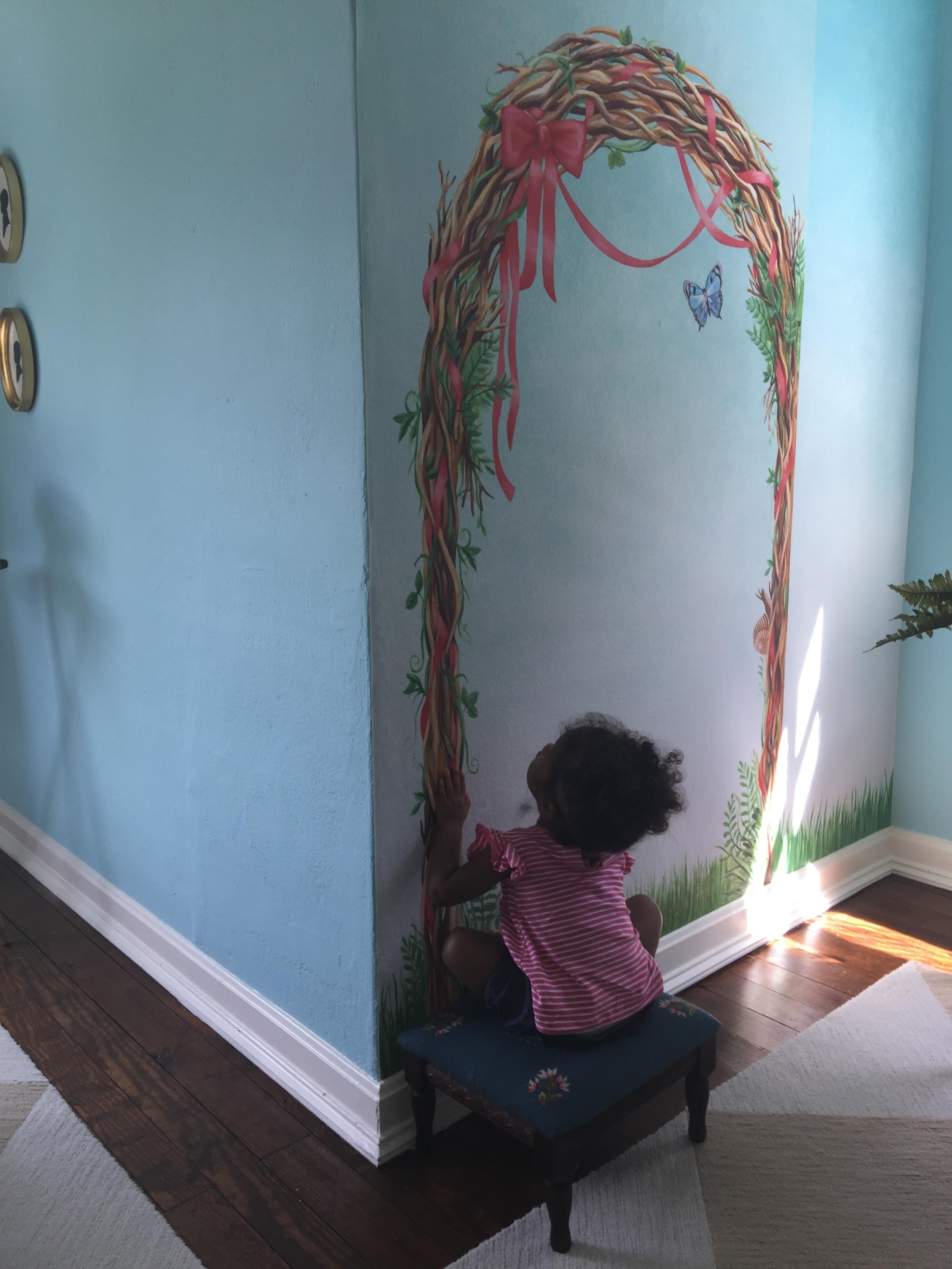 Ava - checking out mural.JPG